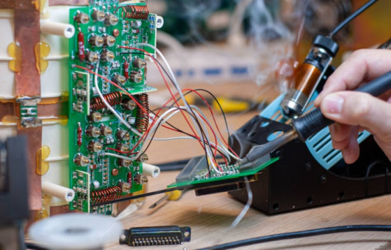 Shot in the electronic laboratory, during tin soldering, for repair